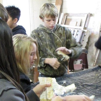 students-skinning-codfish-in-preparation-for-cranfills-gap-lutefisk-supper